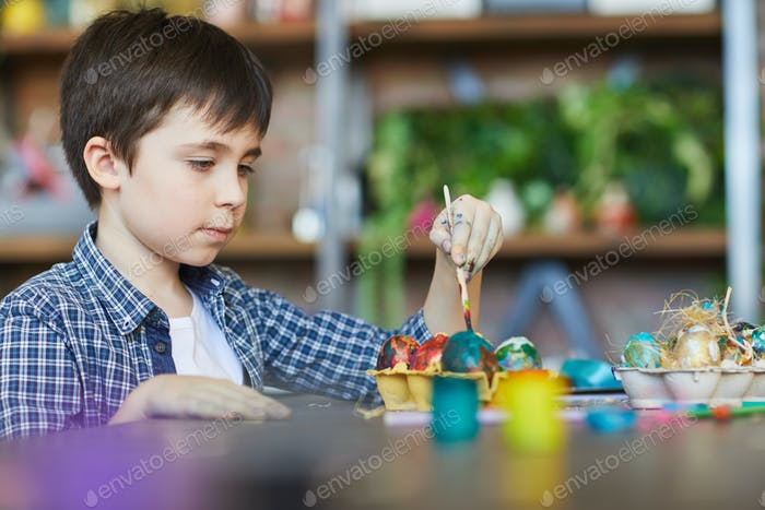 Cute Boy Painting Eggs for Easter