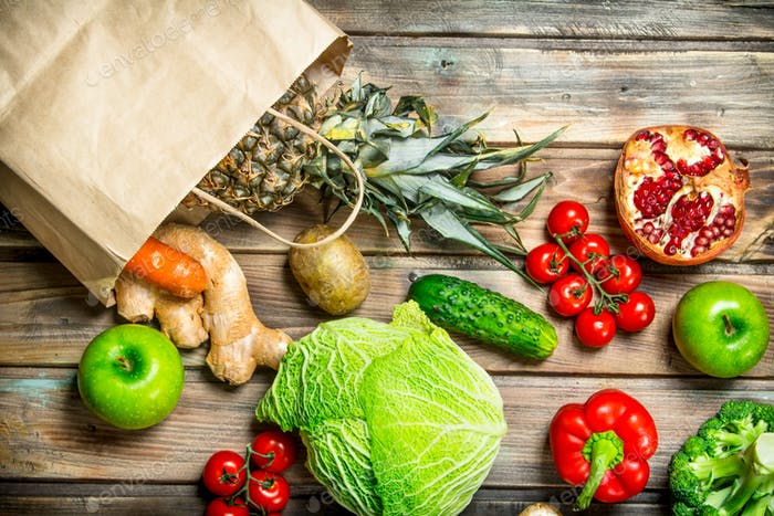 Organic food. Food package with healthy vegetables and fruits.
