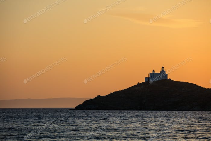 Greece, Kea island. Lighthouse at sunset