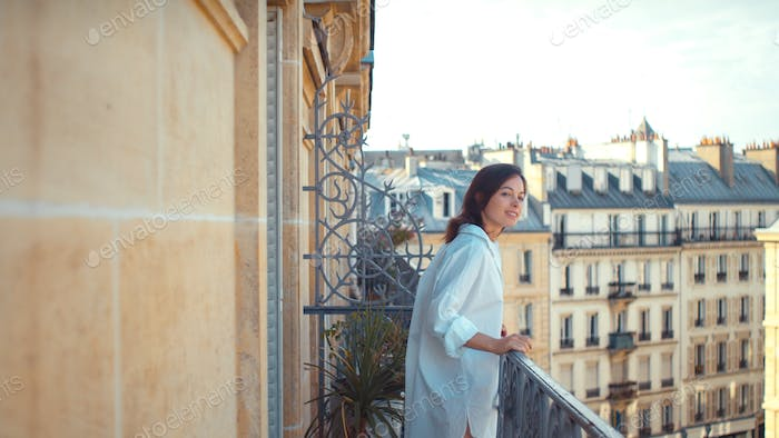 Young woman on a balcony in Paris