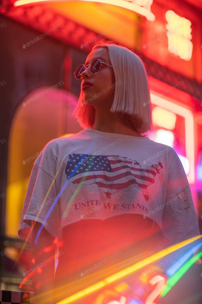 Cinematic portrait of blond girl with white t shirt and american