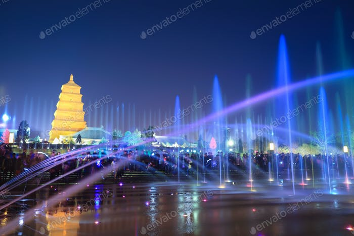big wild goose pagoda with fountains at night