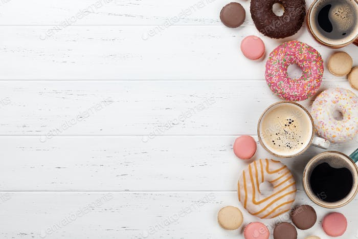 Coffee cups, donuts and macaroons