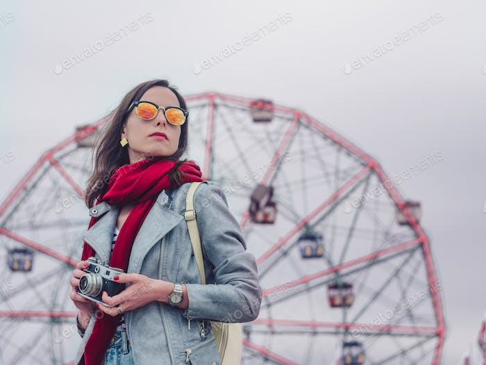 Young girl with retro camera outdoors