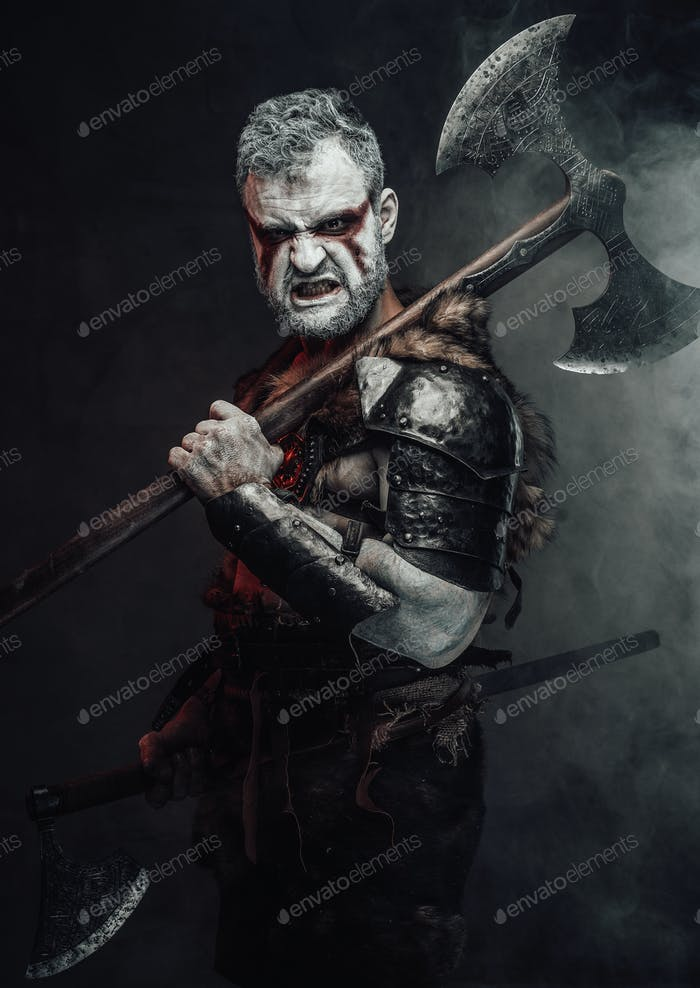 Aggressive fantasy warrior wih two axes in dark background
