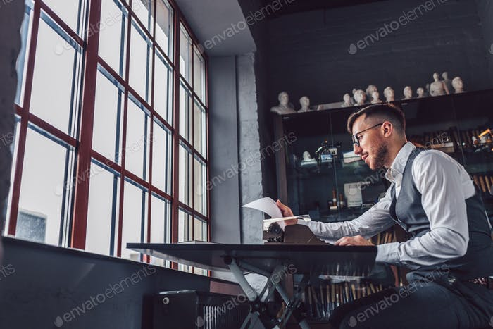 Young professional with retro typewriter