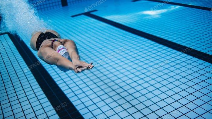 Woman training in swimming pool