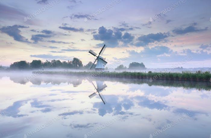 charming Dutch windmill at dawn