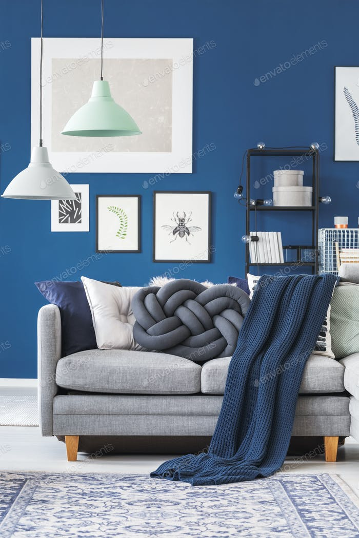 Blue blanket on grey sofa