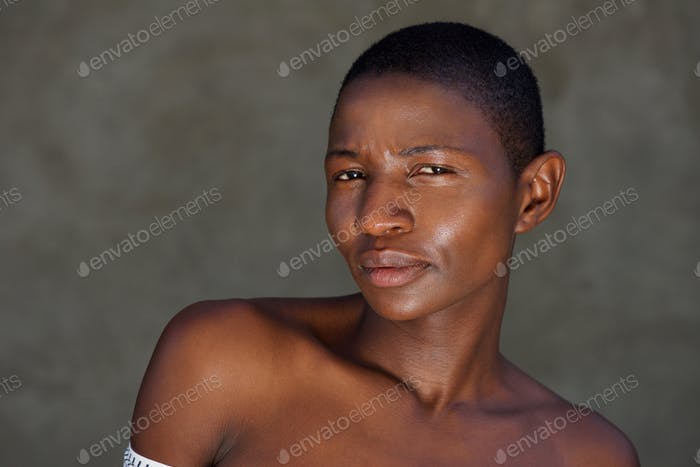 beautiful african woman staring with naked shoulders