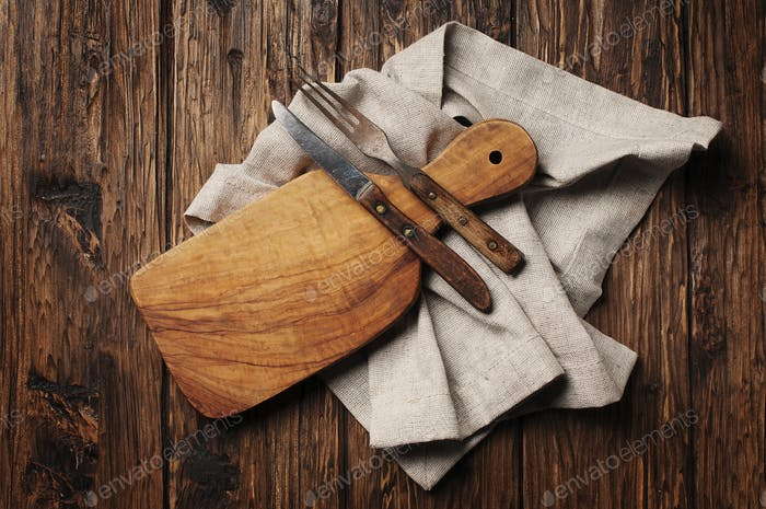 Cutting board on the vintage wooden background
