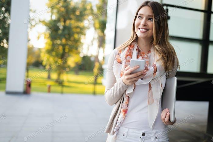 Beautiful brunette girl using smart phone for work, freelance, blogging, studying, shopping