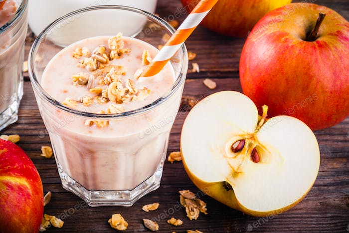 Healthy breakfast: smoothie with granola, red apple and yogurt