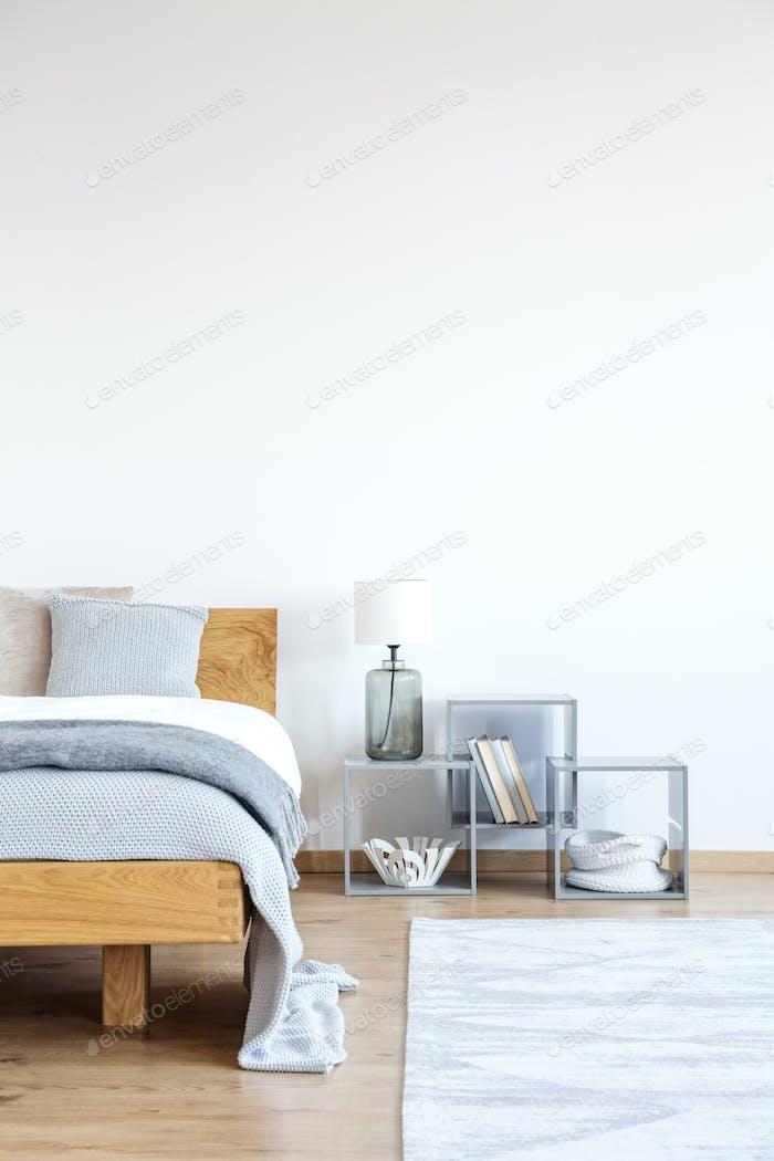 Empty wall in simple bedroom