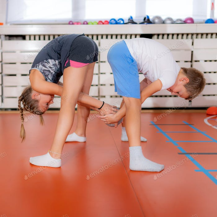 Physically active children exercising with medicine ball