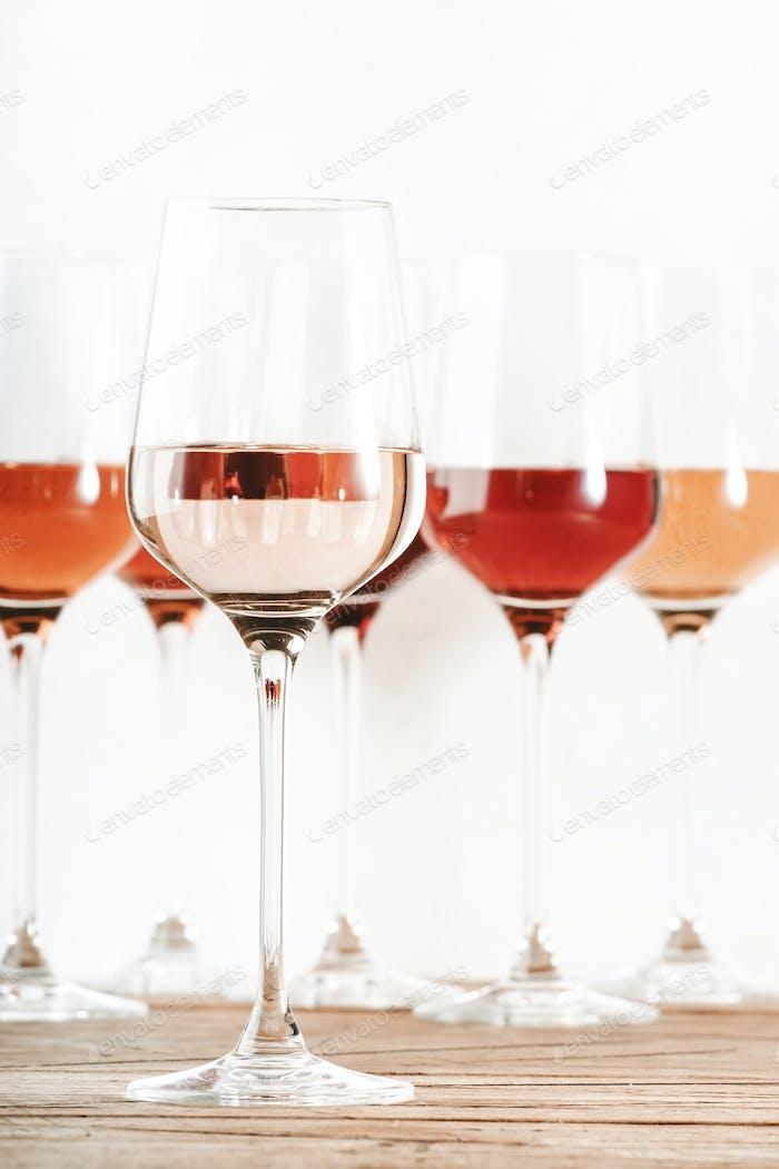 Rose wine glasses set on wine tasting. Tasting different varieties, colors and shades of pink wine