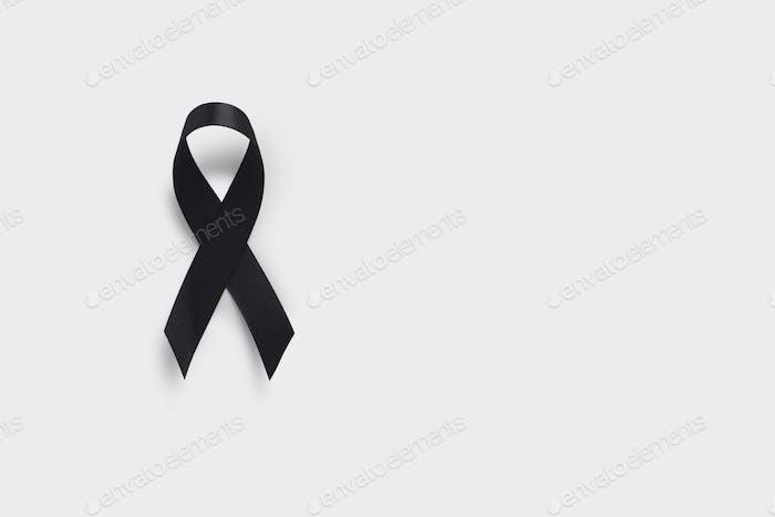 Melanoma and skin cancer awareness ribbon. Realistic Black Ribbon
