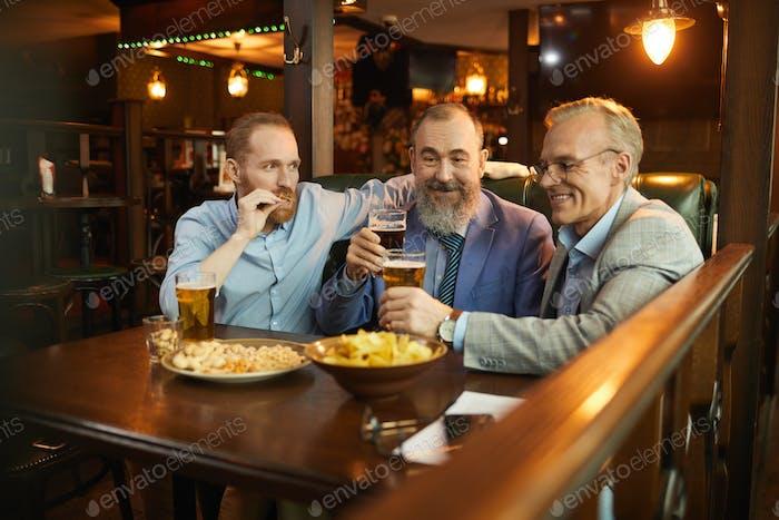 Mature men sitting in the pub