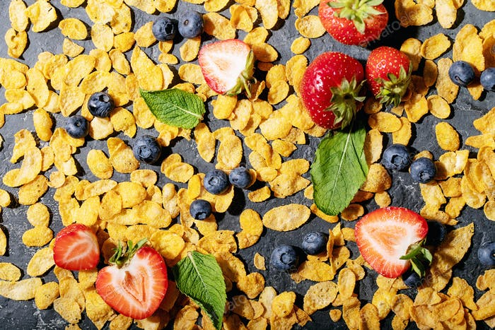 Golden cerials served with strawberry, blueberry