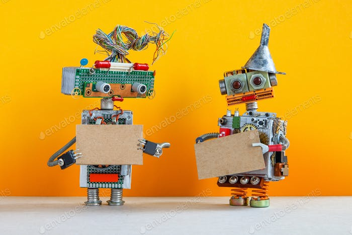 Comical robots with a cardboards mockup.