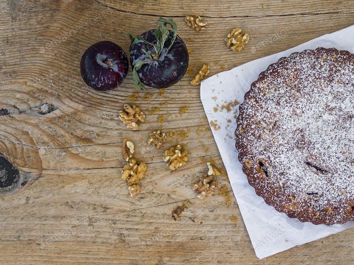 Plum pie with fresh plum and walnuts