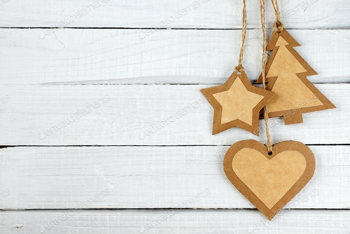 Handmade Christmas decorations on white wooden background