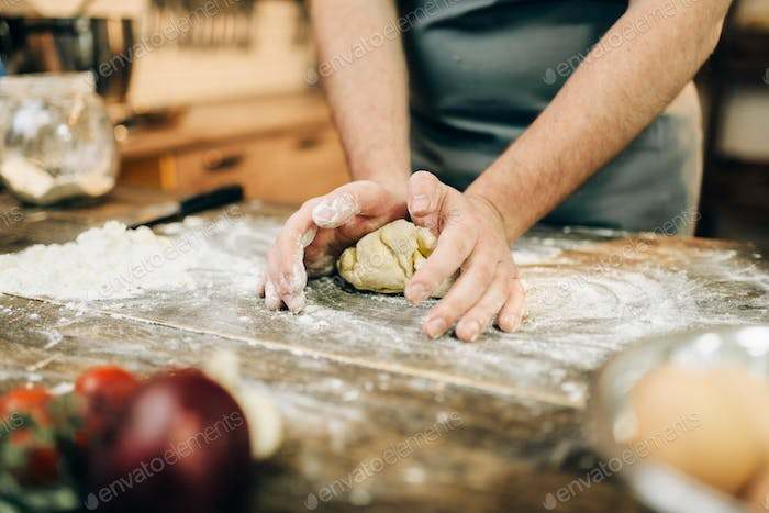 Homemade pasta cooking, dough preparation on table