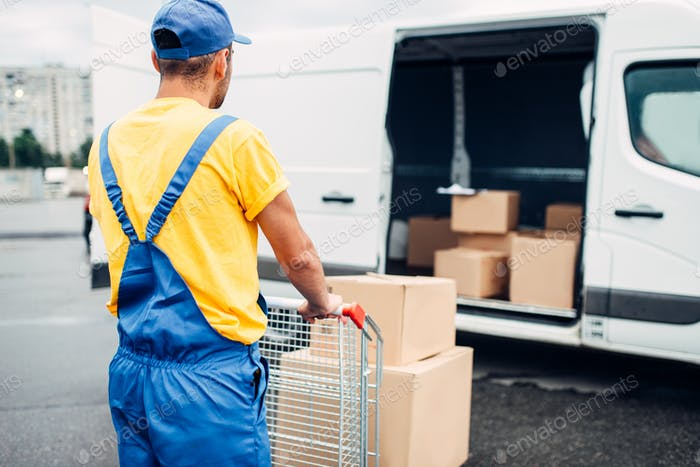Male courier in uniform work with cargo, back view