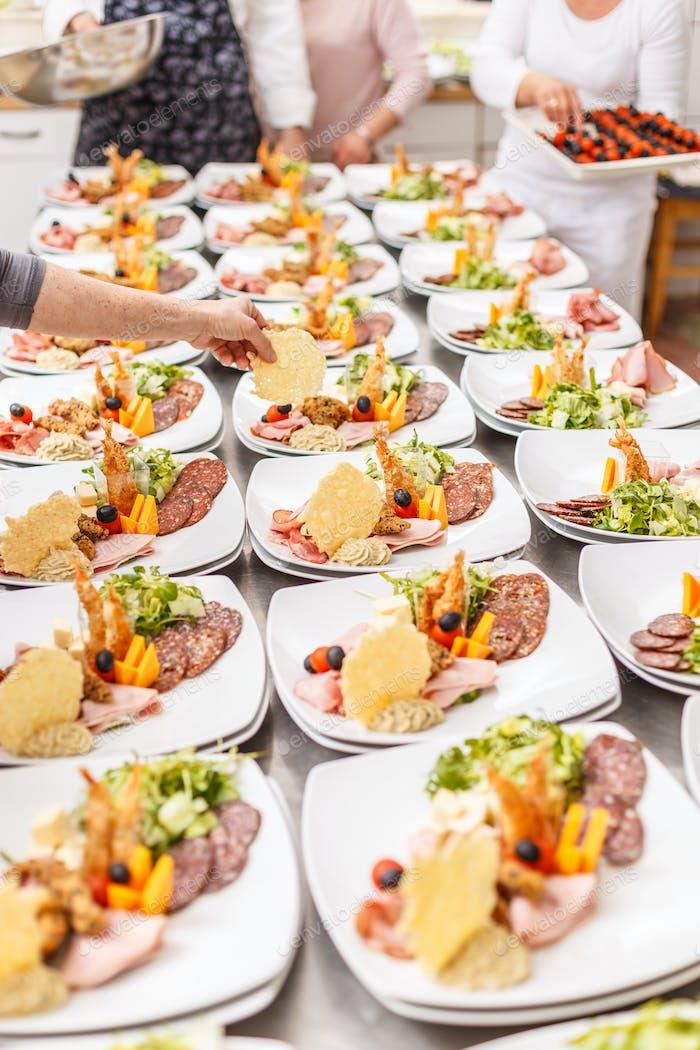 Cook prepare appetizer plates