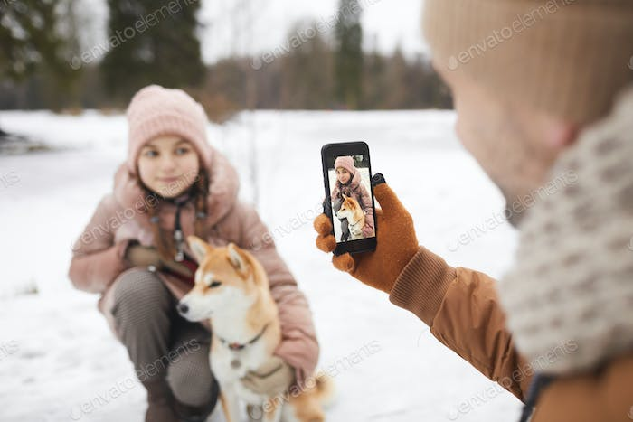 Taking Photo of Girl with dog in Winter Park
