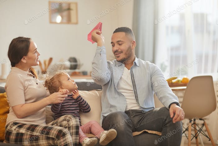 Modern Family Playing with Little Girl at Home