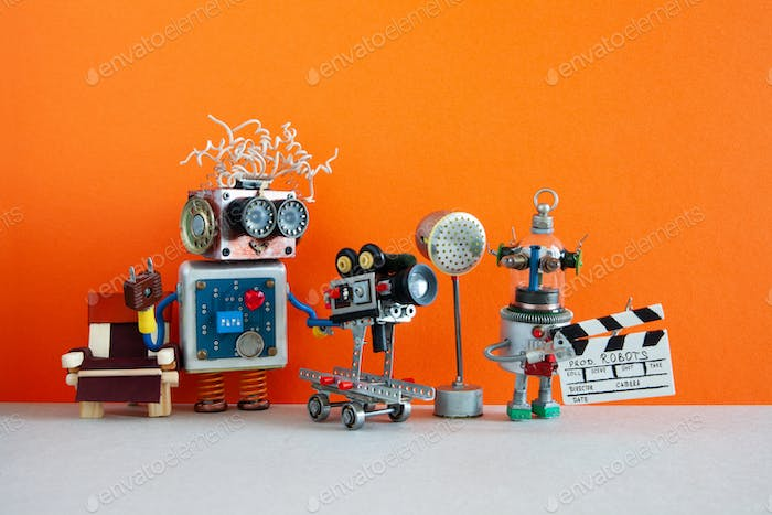 Robotic filmmaking backstage concept. Two robots shoots motion picture