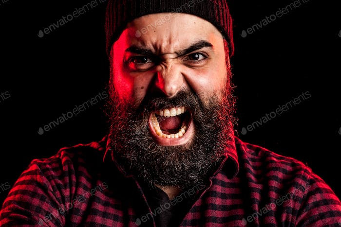 Angry screaming bearded man