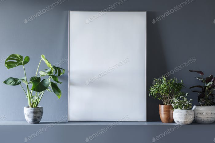 Close-up of mockup on empty white poster in grey room interior w