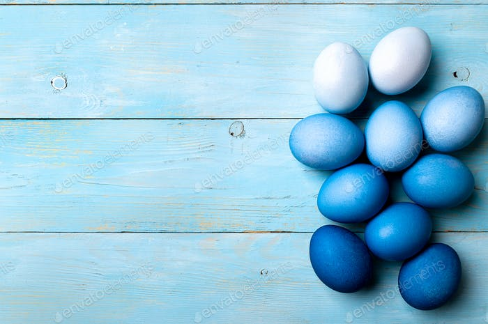 Blue ombre eggs as Easter 2020 concept, copy space