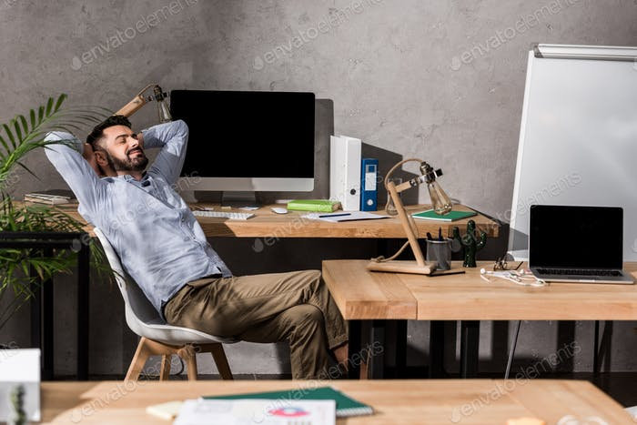 handsome businessman relaxing on chair at office