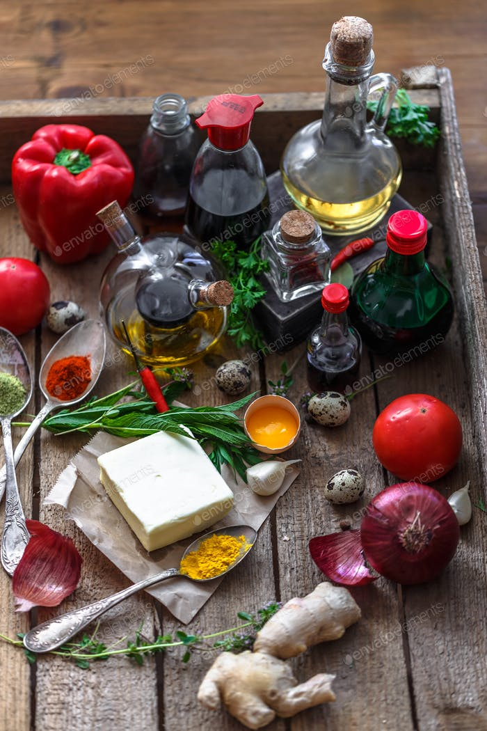 Various spices, oils and sauces selection on wooden background