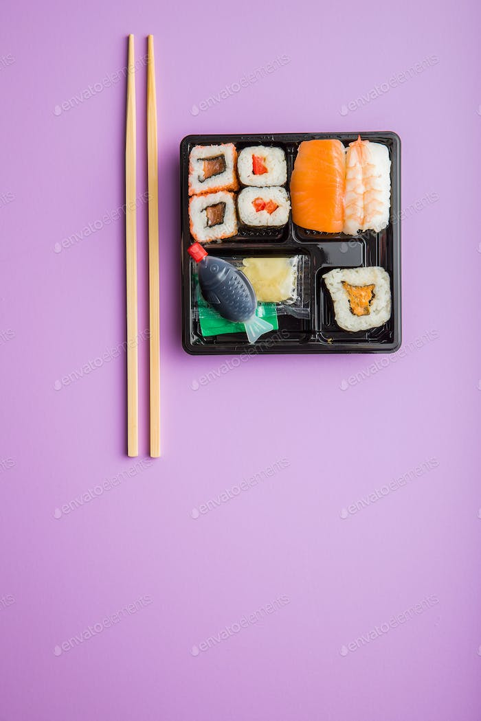 Eating set of sushi.