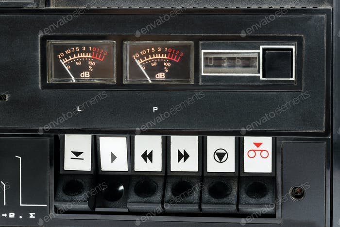 Closeup of control buttons of old audio tape recorder