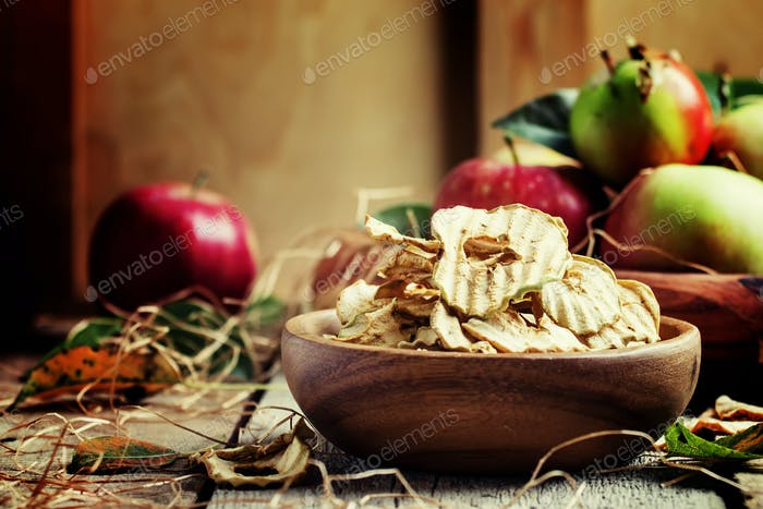 Healthy food: apple chips and fresh apples