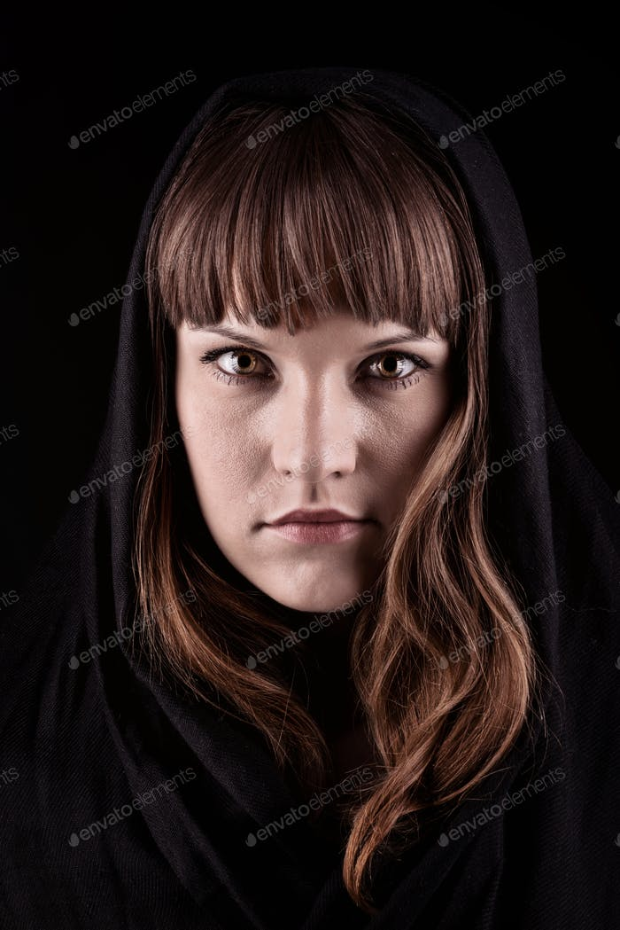 Mysterious young woman on black background