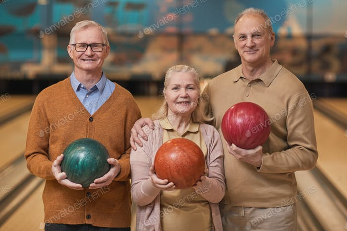Group of Smiling Senior People Posing at Bowling Alley