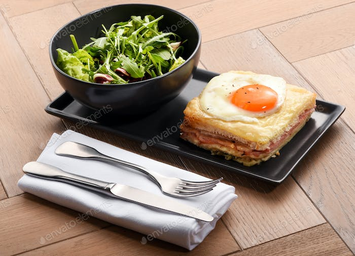 Special club sandwich served with rocket salad