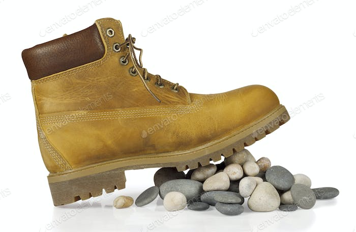 yellow boots on the stones