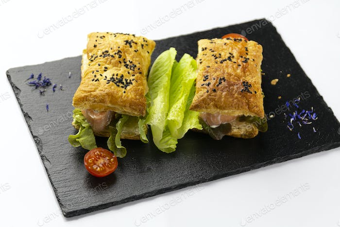 Two sandwiches, with salmon and lettuce