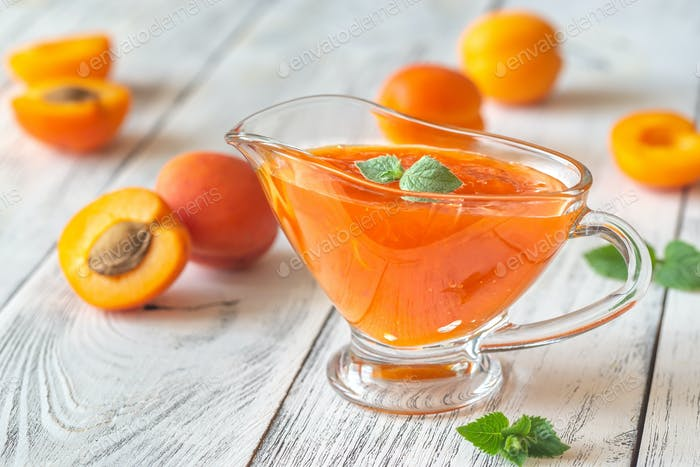 Glass vase of apricot jam