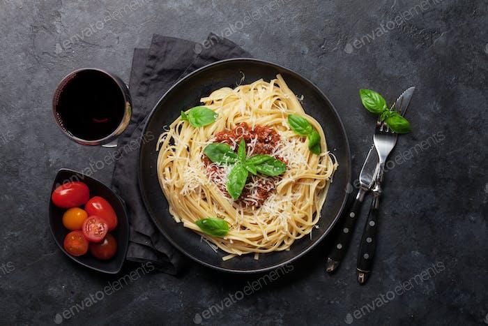 Spaghetti bolognese pasta and wine