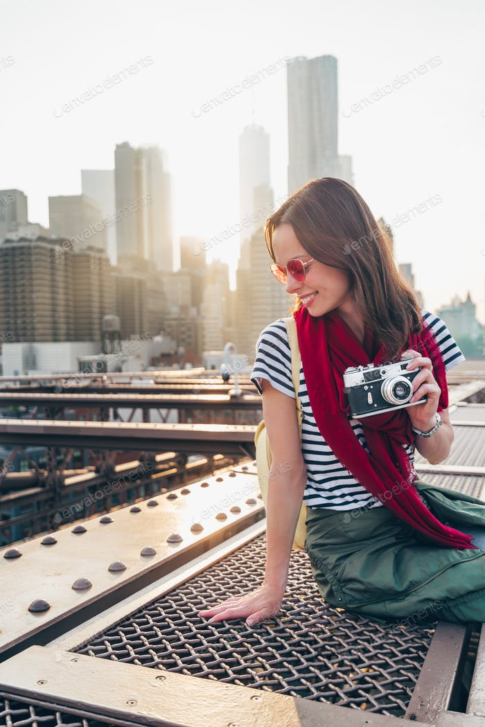 Smiling woman on the bridge