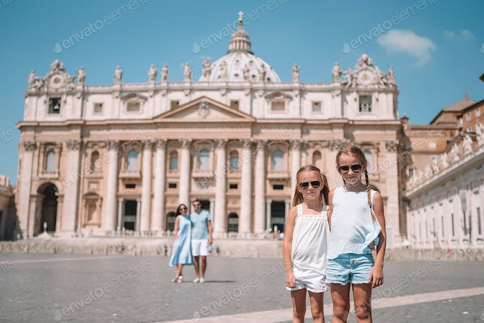 Happy family at St. Peter's Basilica church in Vatican city