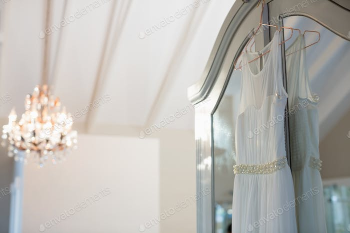 Wedding dress hanging in hanger